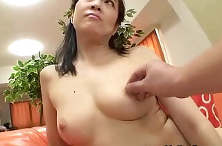 Asian woman gets kinky with toys