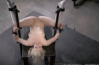 Thin Blonde Submissive In Device Bondage