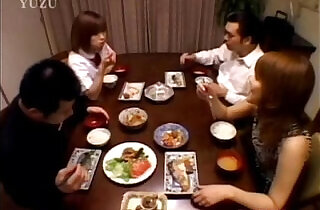 A Asian teenager is sitting at the dining table. Wit from