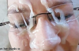 MILF with glasses takes facial