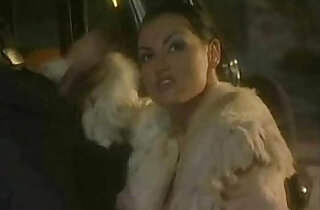 Laura Angel gets Fucked Over A Car In A Fur Coat