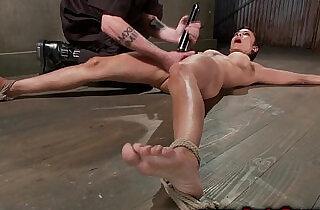 Tied up hanging brunette spanked by her master