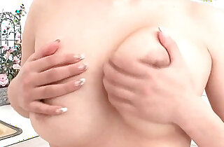 Milk covered HInano fondles her big tits and toys in her pussy