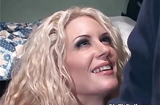 Curly blonde slut takes cock in her